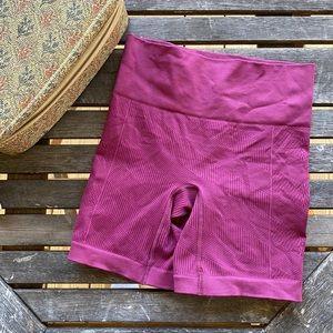 "Lululemon dark pink fuschia 6"" biker shirt size 4"